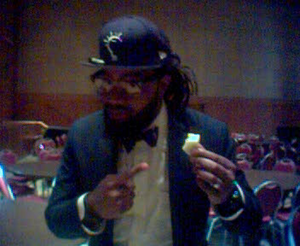 Coltrane Curtis posing with an apple from the Marcus Samuelsson TEDxHarlem talk.