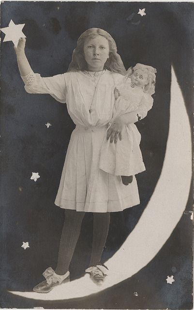 whitephase:  Alice with Her Doll Standing on the Moon - A Real Photo Postcard by Photo_History on Flickr.