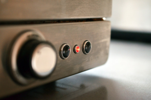 A close up of the buttons on a toaster oven.