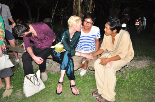 Tilda Swinton, Pratchaya Phintong and Kru Sin, the latter is who made the documentaries that Pratchaya showed the outtakes of. They are sitting at Lung Bao's (Uncle Bao) house whilst everyone is watching the outtakes and drinking fresh coconuts from Lung Bao's coconut garden, picked and cut fresh.