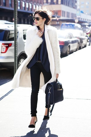 My lovely friend Emily Weiss of Into the gloss rocking Tommy Ton's new bag for CLub Monaco