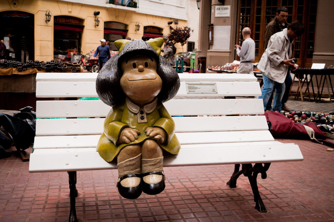 Local hero Mafalda sitting on a bench - San Telmo, Buenos Aires