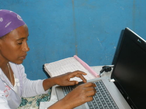 "Gondar- Computer Education Over the past month and a half, we have paid a weekly visit to Askale, a second grade teacher at the Sumarjie School, a school in rural Gondar that was built by the JDC about 2 years ago.  Recently, a laptop computer was donated to the school but since none of the teaching staff had ever used a computer before, we had to teach them.   Now imagine, you are sitting across from someone who has never before touched a computer.  You have been instructed to get her to a point where she can independently use it in about 4 one hour sessions.  How do you go about this? The first hour with her we didnt even turn on the computer (partially because the battery was dead and we didn't have the appropriate outlet, plug, power strip combination to plug it in), we sat with her as she learned what each of the keys do (imagine not understanding the purpose of the space bar let alone how to access the symbol keys), how a mouse works, and where the power button and CD-ROM are located. The next visit with her we did finally turn on the computer and worked with her on how to open a word document, type in a word document, save a word document, edit a word document, and close a word document (it was word-tastic).  Within an hour she was able to out a simple sentence, and change the font, size and color.   During visit three, I brought with me ""Elmos A-Zoo Adventure"" a CD-ROM meant to teach the alphabet, word use, colors, shapes and etc. to pre-school aged children.  I was hoping that by teaching her how it works, she might be able to use the game with her second grade class to work on their English speaking and comprehension skills.  However, seeing how much difficulty she had with the game, I became doubtful that her students would ever use it. However, it is my hope to have the opportunity in the coming months to work with her students on using the game and the computer.  Sadly, though it is likely that these students will grow up with with the same limited knowledge of technology. On lessons four and five we reviewed how to use a word document and introduced her to the basic functions of Excel.  Hopefully, once she gets the hang of it, she will be able to record her student's attendance and exam scores, but as of now it is much more efficient for her to use a pen and paper. This experience has really opened my eyes to the huge differences that can be seen across a few Kilometers here in Gonder.  In Gondar city, we have people that are better at using computers than me (which is not THAT big of an accomplishment), and overall have a population that understands the basics of computer use.  However, all you need to do is drive about 20 minutes in any direction and you hit a population of people that dont understand electricity let alone this complex machine.  It's even more shocking to think about the Western world's dependency on technology and machines, where most 2 year olds can operate an iPad and many households have not one but 3-4 computers. Overall, working just kilometers outside of the city limits of Gondar has showed me how truly different the majority of Ethiopia is from the western world."