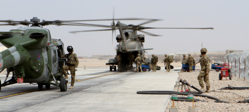 Passengers board a Royal Air Force HC3 Merlin helicopter at the newly christened United Kingdom rotary passenger handling facility aboard Camp Bastion, Afghanistan, March 26. Brig. Gen. Gregg A. Sturdevant, commanding general of 3rd Marine Aircraft Wing (Forward), and Group Captain Jock Brown, commander of the U.K.'s Task Force Jaguar, were on hand to celebrate the refurbishment of the terminal. The updates feature dual refueling points. U.S. and U.K. aircraft typically refuel on opposite sides; the dual fuel points increase efficiency and collaboration between the two nations.Read more: http://www.dvidshub.net/image/549065/updated-uk-facility-increases-joint-us-uk-efforts-afghanistan#.T3MGAZjaZRA#ixzz1qPltiZUJ