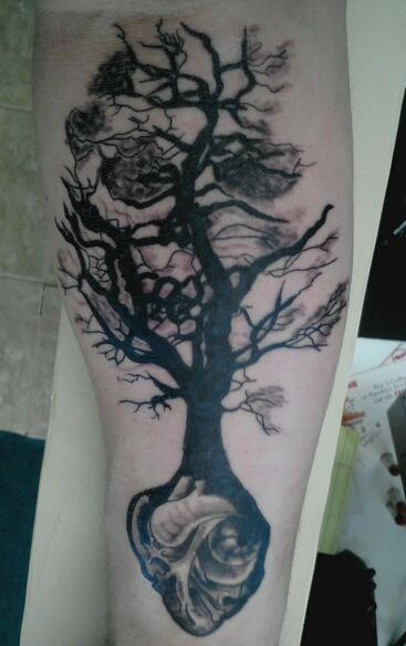 fuckyeahtattoos:  This is my second tattoo. I got it because i saw the tree and loved it. The only problem was in the original picture the tree ended in landscape and i didn't want that so i decided to get the heart to contrast the skull. I am a medic in the army and this tattoo reminds me that i hold others lives in my hands. The power of life or death. It was done by Cory at Sacred body works in massillon, OH. He did a fantastic job and i love it. (P.S. The heart beats when I flex my wrist)