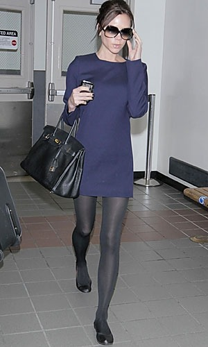 Handbag, $39.98  Victoria Beckham  Is sporting a simple handbag with her outfit.