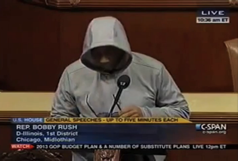 "Rep. Bobby Rush (D-Ill.) donned a hood and dark sunglasses on the House floor this morning, saying, ""Just because someone wears a hoodie does not make them a hoodlum."" As the Republican Rep. Greg Harper banged his gavel, Rep. Rush continued shouting, ""May God bless Trayvon Martin's soul, his family…"" as he was escorted off of the floor and out of the room. Apparently it's against House rules to wear a hat—and Rep. Harper explained, ""The chair finds that the donning of a hood is not consistent with this rule. Members need to remove their hoods or leave the floor."" Here's video."
