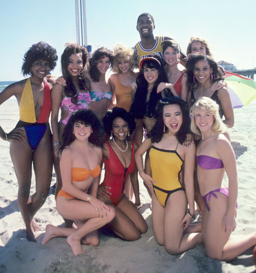 siphotos:  Magic Johnson poses on the beach with a group of bikini-clad women during a 1985 SI photo shoot. Johnson is in the news as he is part of the new ownership group that purchased the Los Angeles Dodgers for $2 billion. (Peter Read Miller/SI) GALLERY: Iconic Photos of the Los Angeles DodgersGALLERY: Rare Photos of Magic Johnson