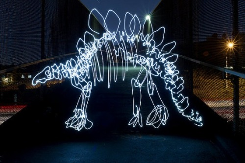 Stegosaurus by dariustwin: Darren Pearson is a graphic designer by day who creates light paintings of dinosaurs at night by waving a flashlight beam in an 'intricate freehand style' in front of the open shutter of a digital camera for 5 - 10 minutes. So interesting because of its impermanence.