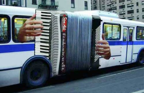 "(From Gothamist)  Musical store ad on the ""accordion"" bus!"