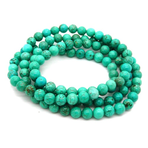 36-inches long howlite gemstone (dyed blue) 8mm beads necklace by Pearlz Ocean. Easy slip on styling