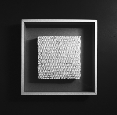 White square in a white frame. 2008. Cotton buds, frame, glass.