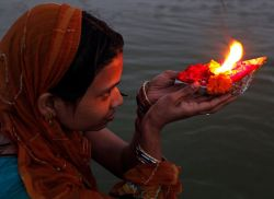 A Hindu women offers prayers on the banks of the River Ganges, on World Water Day in Allahabad, India, March 22, 2012.