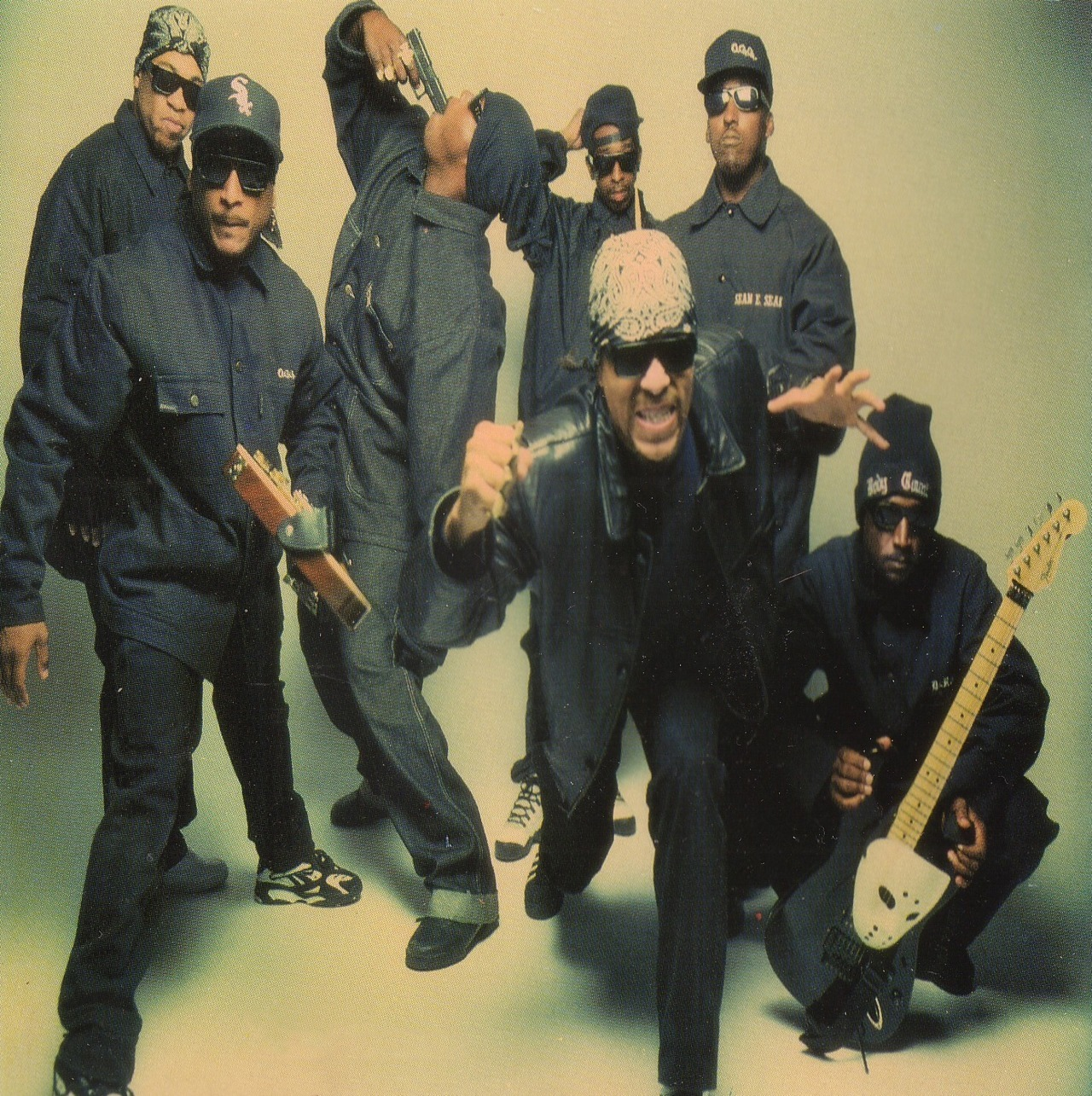 "BODY COUNT: LIFE AND TIMES OF HUSTLA' LOLLAPALOOZA SAN FRANCISCO 1991 Whoever said hustlin' ain't easy never met Ernie C. Back in 1991 I was working for Jello Biafra at Alternative Tentacles Records in San Francisco. It was that year, or maybe the year before, that Ice-T's heavy metal band Body Count had released an album that opened with a sample of one of Jello's spoken word recordings. Ice was a big fan of Dead Kennedys and Biafra. When Ice-T took Body Count out for their inaugural tour as a part of the first  Lollapalooza fest, he invited Jello to come out and say hello.  Biafra, myself and the rest of the small A.T. staff had been planning to go to the festival anyway because our friends in Nine Inch Nails were playing, and even if they hadn't been, we had peeps at Bill Graham Presents who always got us into shows out at the Shoreline Amphitheater in the suburbs near San Francisco where Lollapalooza would soon be happening. Jello let Ice know he'd be there. Luckily, I'd be there too. Yeah, I was waaaay cool back then. The festival was fun, totally sunny, tons of people, great bands, we got backstage, ate good food, I met some of the rockstars milling about, and ate way too many Jell-o shots. It just struck me… I don't remember Jello having any Jell-o shots… Each of the acts playing the fest had their own set of mobile-classroom type backstage trailers. We found Body Count's trailers and stopped by to visit. The guys were hanging out, looking very cool, very Gangsta. They were all super nice, Ice-T was as friendly and down-to-earth a man as you could hope to meet, and it was all very pleasant. We had been chatting for while when the band's lead guitarist Ernie C., who had been absent until now, entered the scene carrying an empty duffle bag, looking amused and more than a little bit pleased with himself.  Ernie C. (who Ice would later introduce from the stage colorfully as ""…the ignorant lil' n-gga on lead guitar…"") explained to everyone where he had been. He told us he was outside in the parking lot of the venue selling Body Count T-shirts directly to fans as a way of circumventing having to give Bill Graham Presents the 20% cut they took off the top from the legitimate merchandise stands run by their staff inside the place.  Security had busted Ernie in the parking lot and refused to believe he was in the band, which is not an unreasonable assumption for them to have made, after all: why would a rockstar be out in the parking lot standing in the hot sun selling his band's t-shirts from a duffle bag? You can't really blame the security for not knowing that the reason this was happening was because this particular rockstar happened to be a CERTIFIED HUSTLA' off the streets of South Central Los Angeles by the name of ERNIE C.! …that's why! Ernie smooth talked, shrugged off, and ultimately convinced security he was legit without having to give up one dollar of the fat stack of cash he'd earned out there. Score one for Ernie C.! Later as we left, Biafra mentioned to Ice-T how much he admired the oversized, black, padded jackets the band was wearing. The ones with the embroidered Body Count Logo on the back that was a take off on the famous Oakland Raiders logo. Ice asked if he wanted one and Biafra said he did. As soon as Jello expressed his wish, Ice told one of his entourage to ""give the man your jacket"". Much to the apparent chagrin of the big dude wearing the jacket in question I might add.  The A.T. guys and I protested that it wouldn't be right and it was far too kind to give Jello the jacket off the guy's back. Biafra thought it was okay however and that the guy could always get a new one and so it was that Biafra took the jacket and put it on along with his new Body Count stocking hat. The only thing missing from his ensemble were the dark, wrap around shades. Score one for Biafra. Body Count photo from the web."