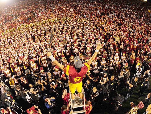 USC quarterback Mark Sanchez leads the Trojan Marching Band after the 2009 Rose Bowl against Penn State. Sanchez has been in the news this week after the Jets traded for Tim Tebow to be his backup. (Robert Beck/SI) GALLERY: Rare Photos of Mark Sanchez