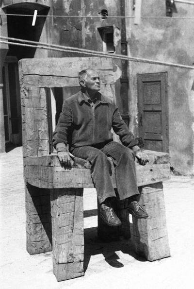 "Bohumil Hrabal (born 28 March, 1914; died 3 February, 1997), pictured above in a photograph in the collection of the National Museum of Photography, Jindřichův Hradec (I wish I had more information about this photograph; alas, I do not) 'Suddenly the door opened and in stomped a giant, reeking of the river, and before anyone knew what was happening, he had grabbed a chair, smashed it in two, and chased the terrified customers into a corner. The three youngsters pressed against the wall like periwinkles in the rain, but at the very last moment, when the man had picked up half a chair in each hand and seemed ready for the kill, he burst into song, and after conducting himself in ""Gray Dove Where Have You Been?"" he flung aside the halves of the chair, paid the waiter for the damage, and, turning to the still-shaking customers, said, ""Gentlemen I am the hangman's assistant,"" whereupon he left, pensive and miserable. Perhaps he was the one who, last year at the Holesovice slaughterhouse, put a knife to my neck, shoved me into a corner, took out a slip of paper, and read me a poem celebrating the beauties of the countryside at Ricany, then apologized saying he hadn't found any other way of getting people to listen to his verse…'  —from Too Loud a Solitude: A Novel (1990; originally published in 1976; translated from the Czech by Michael Henry Heim)"