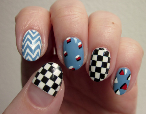 Mixing patterns & mixing nail strips and nail art :) I would do a beer post… but I probably won't get a chance to drink a beer I haven't had or posted before until after I work a shift tomorrow, and I don't know what this mani will look like after 6 hours of being repeatedly covered in beer, water and glassware sanitizer.
