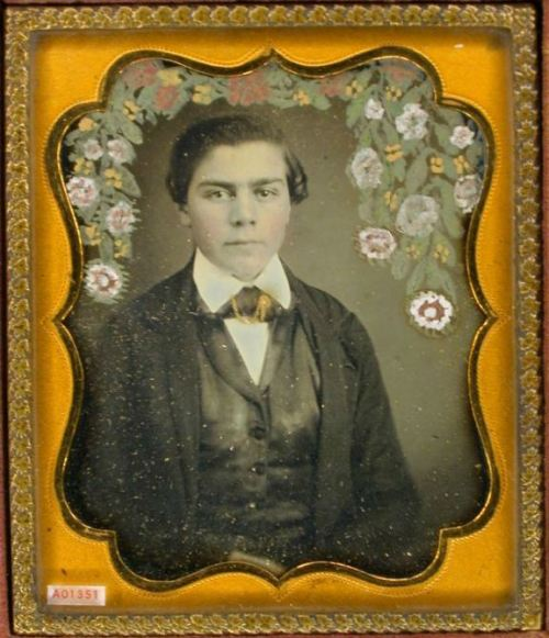 ca. 1850's, [daguerreotype portrait of a gentleman with flowers painted on plate in wreath motif over his head] via the Daguerreian Society, Greg French Collection