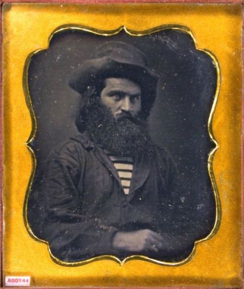 ca. 1850's, [daguerreotype portrait of a gentleman with large beard, wearing hat, work shirt, horizontal striped miner shirt] via the Daguerreian Society, Matthew R. Isenburg Collection