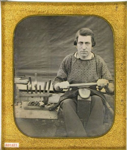 tuesday-johnson:  ca. 1850's, [daguerreotype portrait of a shoe maker/cobbler wearing earrings, holding tools] via the Daguerreian Society, Greg French Collection