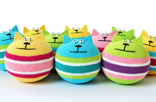 mymorningcoffeee:  Amigurumi crocheted stress relief cats in light of my new found goal to learn how to crochet cute things. SashaKulaKova is selling a PDF file of the pattern! After crocheting the cat, you fill it with polysteren pellets or poly-fill, making the cutest squeezable stress reliever around.