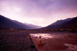 greenshirts:  An Afghan man prays at sunset following a rainstorm in Kunar province.  Beautiful.