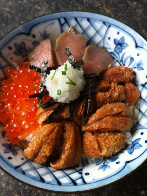 UNI, ABURI TORO & IKURA OVER RICEAlso known as sea urchin roe, lightly grilled tuna belly and salmon roe over a bed of sushi rice. Garnish with seaweed, grated daikon and chives.