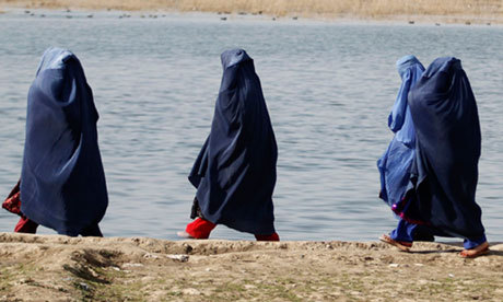 "Afghan women are being jailed for 'moral crimes', says report Courts failing to protect women, many of whom are in prison for running away from home or adultery, says Human Rights Watch Nearly half of all women in Afghan prisons are being held for ""moral crimes"" such as running away from home or adultery, according to a report by Human Rights Watch. After more than a decade of international efforts to reform the legal system and women's rights in Afghanistan, the report found that despite a number of improvements, women still face extremely limited protection in the court system. The report focused primarily on the imprisonment of women who fled their homes to escape abusive situations. In almost all such instances, those responsible for the abuse did not face any legal actions, while the victims faced prison sentences. Afghanistan is the only country in the world that interprets sharia law to prohibit women from running away from their home without permission. ""In our view this misuse of the made up crime of running away is emblematic of the difficult position that women find themselves in Afghanistan today. There has obviously been progress in education for women and healthcare for women and employment and travel for women. That's all been good, but the progress that has been made is precarious,"" said Kenneth Roth, executive director of Human Rights Watch. ""Particularly as the international community pulls back militarily from Afghanistan we believe that it's important too that the Afghan government and the international community recommit themselves to the rights of all Afghans, including women,"" he added. In one case described by the HRW report, a woman named Souriya Y was given away for marriage at the age of 12 to resolve a family dispute. Her husband was abusive, but her father encouraged her to be patient. Nine years into the marriage, her husband accused her of running away and having sex with one of his enemies. Souriya told HRW she saw the man she was accused of running away with for the first time in court and says her husband made up the story to get rid of her and shame his rival. She was convicted and sentenced to five and a half years in prison. The report follows numerous similar indicators that present a stark situation for women. A UN report published in winter found that despite the creation of a law designed to protect women, nearly two years after its inception it is rarely enforced. Meanwhile, a separate report by Oxfam found that 87% of Afghan women reported experiencing physical, psychological, or sexual abuse or forced marriages. With a legal system that often punishes women for reporting violent crimes against them such as rape or abuse, a number of women do not speak up for fear of facing judicial reprisal. Pictured: Women's rights in Afghanistan have improved but the situation could deteriorate when international forces leave the country, according to a Human Rights Watch report. Photograph: Mohammad Ismail/Reuters"