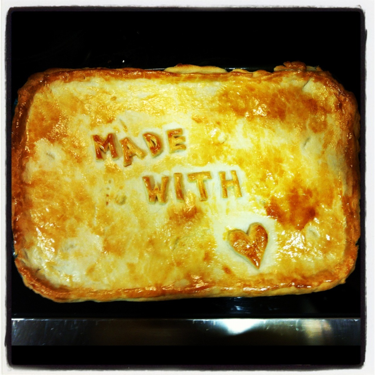 Matt's Chicken Pot Pie (Made With Love) YUMMY! Chicken pot pie is one of my favorite hearty (and also fatty) home-cooked meals. My mom used to make it for my brother and I growing up, so just the idea of chicken pot pie makes me happy. My brother gave me this delicious and very simple recipe and if it didn't make such big portions, I would make it all the time! I went on an amazing trip to Lake Tahoe with my boyfriend Zack and we made this together for dinner. It turned out really well and he was still thinking about it weeks later! Ingredients: 1 chopped onion 1 chopped carrot peas & corn (or any other veggies you like) 1 russet potato diced mushrooms 2-3 chicken breasts raw chicken stock (32 oz) OR 2 chicken bullion cubes + 6 cups water  heavy whipping cream flour  one egg *optional: uncooked hard little beans*   HOW TO:  - Sauté diced chicken with salt and pepper in a pan, don't worry too much about cooking it all the way through. Meanwhile, bring veggies (potatoes and mushrooms)  to boil in the chicken stock (and water if you need to add some. Or the two chicken bullion cubes and water). Once chicken is sauted, toss into veggie stew with peas and corn.  Allow stew mixture to simmer - NOT BOIL - for 20-30 minutes.  Add heavy whipping cream and stir. Put 1/2 cup of flour in a large mixing bowl. Use ladle to remove 6 ladles worth of stock mixture without any veggies, pour into bowl and whip with a whisk. ***Whisk until smooth!!! There need to be NO chunks. If it gets chunky, add more hot stew broth and keep whipping it, the chunks will disappear.*** Make it to desired consistency, it will thicken slightly in the oven. Put thickened mix back into pot. Preheat oven to 325. Buy sheets of pie crust or puff pastry sheets. Line pregreased (with butter or canola vegetable oil) casserole dish with pie crust. Line this with aluminum foil. Fill with uncooked beans. Cook for 10-15 minutes at 325. If it's a glass dish you can check through the glass to see the color of the dough. You want it to have gone from white to yellow, but not fully cooked. Take out of oven, remove foil and beans. Put pie filling in. Add top unbaked layer of pie crust to the top. Decorate. Cut little slits in the top layer. Brush the top layer of the pie with one raw beaten egg. Bake at 325 until the top layer is perfectly golden brown. Tada!