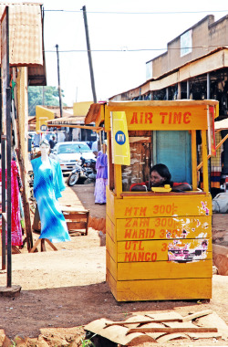 typicalugandan:  MTN Mobile telephone booth, Uganda. Photography by andrea.sosio
