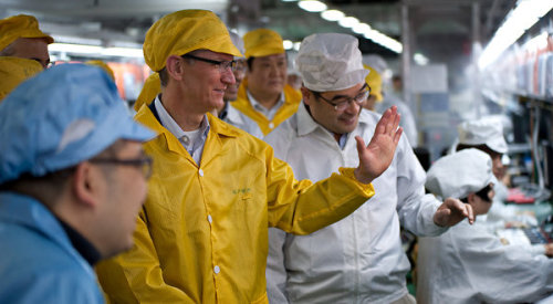 That's Apple's Tim Cook. Visiting a Foxconn production line in Zhengzhou, China. Not many details known about his visit yet, but basically the Apple CEO is in the midst of some PR cleanup after a string of controversial reports about Apple's manufacturing processes — some of which have been proven somewhat suspect. (photo by Bowen Liu/Apple Inc., via Bloomberg News)
