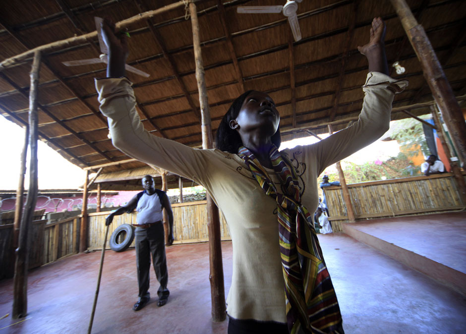 Actors from the South Sudan Theatre Company perform during theatre training as they prepare for the upcoming World Shakespeare Festival, in Juba March 27, 2012. Thousands of artists worldwide including South Sudan will participate in about 70 productions, supporting events and exhibitions in Britain as part of the festival. The festival takes place from April 23. [Credit : Mohamed Nureldin Abdallah/Reuters]