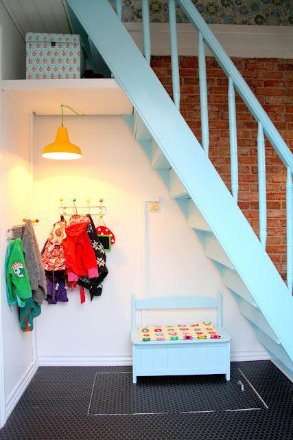 adorable under-stairs area (via bare WUNDERBAR)
