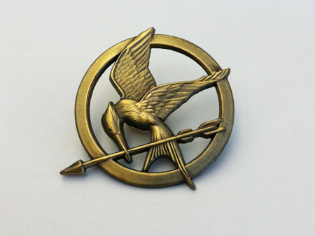 "Let's start with a topic near and dear to my heart - The Hunger Games. The beginning of what is sure to be a massive movie trilogy did more than blow box office sales out of the water ($155 million in the first weekend), it launched a viral social media campaign that captured current and future fans weeks before the premiere. And as a complete Hunger Games fan girl, I loved it. The campaign included 13 Facebook pages - each representing a district in the film that interacted with its ""citizens"" through photos, posts and questions. Each interaction was tweaked to represent the uniqueness of that district and drum up a sense of true community. The Capitol had its own Twitter handle that has more than 62,000 followers, tweeting promotional tweets as well as questions and comments as if it was truly the Twitter account of the ruling city of Panem. Websites popped up for everything from securing your name and how you died in the Hunger Games to assigning fans a district, name, and allowing you to compete for the role of mayor. A Tumblr was even created to highlight the fashions of The Capitol and their citizens. Showing sneakpeaks at the over-the-top look that came to life on screen. And this is just the beginning. Due to my interactions with the sites above I got frequent, but not overwhelming emails from President Snow himself, urging me to get my tickets and prepare for the 74th Annual Hunger Games. Everywhere you looked online people were talking about the movie, posting links and photos and tweets about their excitement and the information leaked in advance.  The Hunger Games was not the first movie to turn to digital and social media to generate buzz and will not be the last, but their ability to capture the essence of the movie, the characters and The Capitol also captured the fans. And while we'll never know the direct correlation between the social media push and massive ticket sales, it's hard to argue that it didn't help. I'll admit, I've already seen it twice.  May the odds be ever in your favor. Did you see the Hunger Games or interact with the movie via social media before it came out?"