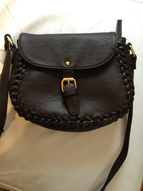 Just got my new Brandy Melville bag in the mail! I love it. It fits my keys, cell, and wallet without being too big. Perfect for summer strolls.