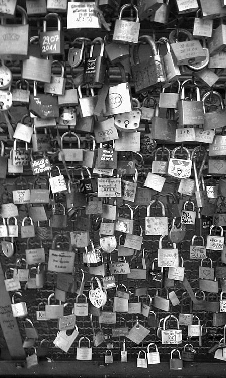 "h0lybible:   ""Love Locks"" You and a friend carve your initials into a padlock, attach the padlock to a bridge and throw the key into the river, so that even if the friendship fades the padlock will always be there to remind you of the good times.   this is so beautiful   I've got one on the Arts bridge :-)"