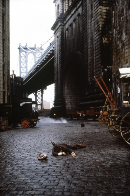 Once Upon a Time in America (Sergio Leone, 1984) The bridge towering over the warehouses, an image so striking it was used for the poster art and DVD cover, is Manhattan Bridge, Water Street at Washington Street, once again, over in Brooklyn.