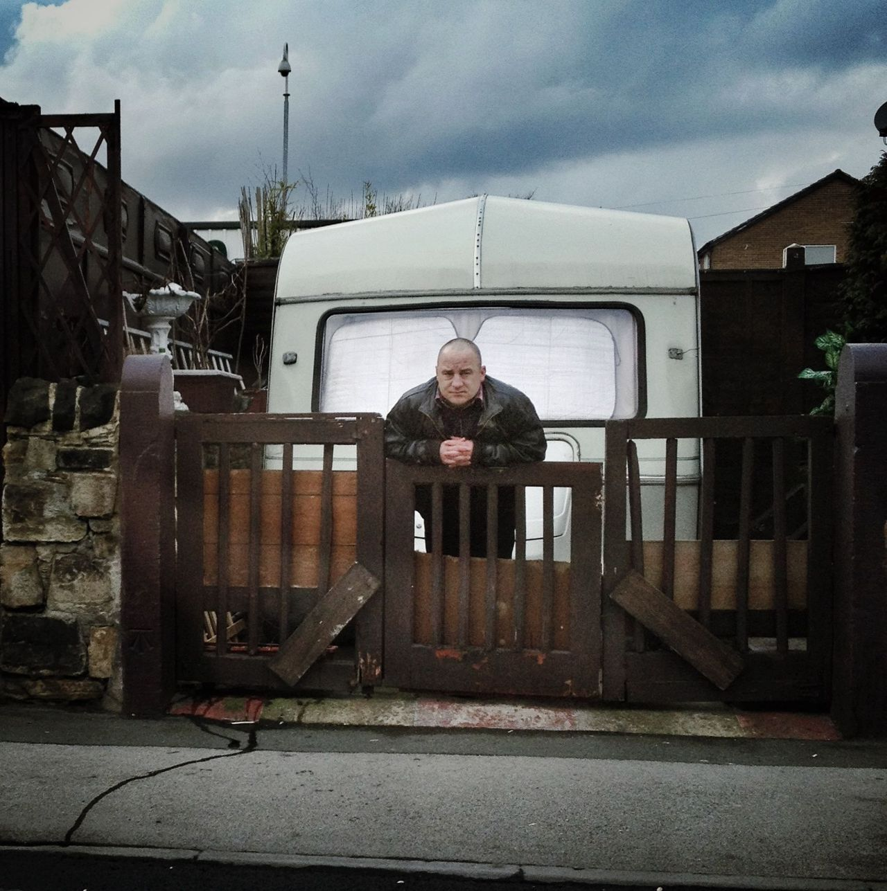Photo by AMPt member Graham Preston(IG: @grahampreston)Title: An Englishman's HomeFor me, having a camera on my person at all times means that when the opportunity for a photo appears, I can take it - instead of thinking afterwards 'that would have made a nice image, I wish I had my camera'.So here is one of those moments. This bloke didn't look like your typical caravan enthusiast but it was parked outside his small house and he was guarding it. I did not hang around to find out why.I spot the opportunity. Unlock my phone (QuickPix is usually open and ready). Raise and shoot two frames and move on. Later I cropped square in Snapseed, then applied slight drama filter to lift the shadows a bit. Next vintage filter style 3 with texture at zero and saturation boosted.More from Graham Preston on Instagram