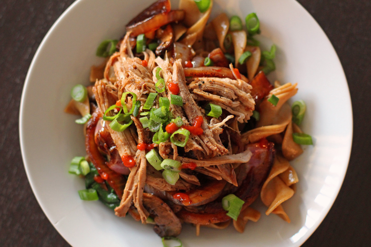 Slow Cooker Asian Style Pork - First Way: Over Egg Noodles with Spinach, Mushrooms, and Onions Okay, so I needed a sort of cost efficient meal that would last at least 3 days.  So I decided on a slow cooker pork recipe because I can use the shredded pork over a course of like four days and do something different with it each day.  I came across a recipe that I really liked that inspired this idea.  My inspiration came from SkinnyTaste once again.  Then because I couldn't find a five spice blend at my normal grocery store (I didn't want to go to the Asian grocery store), I ventured off onto Google to find a different Asian flavored slow cooker pork recipe hoping to come across something that didn't include five spice.  I wasn't that successful but this second recipe did wow me and I love these flavors so I decided to use this recipe (minus the five spice blend) and incorporated how SkinnyTaste puts her meal together.  I wasn't surprised that this dish was going to be pure gold!  As soon as I came home from work, I didn't even need to imagine how delicious this would be, the smell alone was awesome!  It was freaking yummy!  Try it out! Recipe for the sauce I ended up using found on the MyRecipes website my changes or adaptations are italicized.  Ingredients 1/4 cup  low-sodium soy sauce (I ran out of normal soy sauce so I used what I had which was a Mushroom Flavored Dark Soy Sauce)   1/4 cup  hoisin sauce   3 tablespoons  ketchup   3 tablespoons  honey   2 teaspoons  bottled minced garlic   2 teaspoons  grated peeled fresh ginger   1 teaspoon  dark sesame oil (allergic to sesames so opted out of this)   1/2 teaspoon  five-spice powder (didn't have any on hand, opted out of this too)   2 pounds  boneless Boston butt pork roast, trimmed 1/2 cup  fat-free, less-sodium chicken broth Additional items for this specific meal:  whole wheat egg noodles, handfuls of fresh spinach, one red onion, 8oz of mushrooms, and of course Sriracha Directions Combine first 8 ingredients in a small bowl, stirring well with a whisk. Place in a large zip-top plastic bag. Add pork to bag; seal. Marinate in refrigerator at least 2 hours, turning occasionally.  I didn't have time to marinate, so I just seared the pork on all sides in a skillet (method from SkinnyTaste) and created the sauce mixture and put the pork and the mixture into the crock pot all at once.   Place pork and marinade in an electric slow cooker. Cover and cook on low for 8 hours.  Again, this was very last minute, so I cooked this on high for 4 hours.  Remove pork from slow cooker using a slotted spoon; place on a cutting board or work surface. Cover with aluminum foil; keep warm. Add broth to sauce in slow cooker. Cover and cook on low for 30 minutes or until sauce thickens. Shred pork with 2 forks; serve with sauce. This next part I used SkinnyTaste's recipe for inspiration and for what to do with the veggies.  I removed the pork from the slow cooker and let it rest in foil.  I put an 8oz container of baby bella mushrooms into the slow cooker along with sliced red onions.  I let this cook on high for 20 minutes while I shredded the pork.  I cooked two servings of whole wheat egg noodles and right before draining the egg noodles I put a few handfuls of spinach in and cooked it for a few seconds. I then took some of the egg noodles/spinach and tossed it in with a bit of sauce from the slow cooker to get a good coating.  I topped the egg noodles/spinach with the shredded pork, the mushrooms/onions, and garnished with scallions and sriracha!