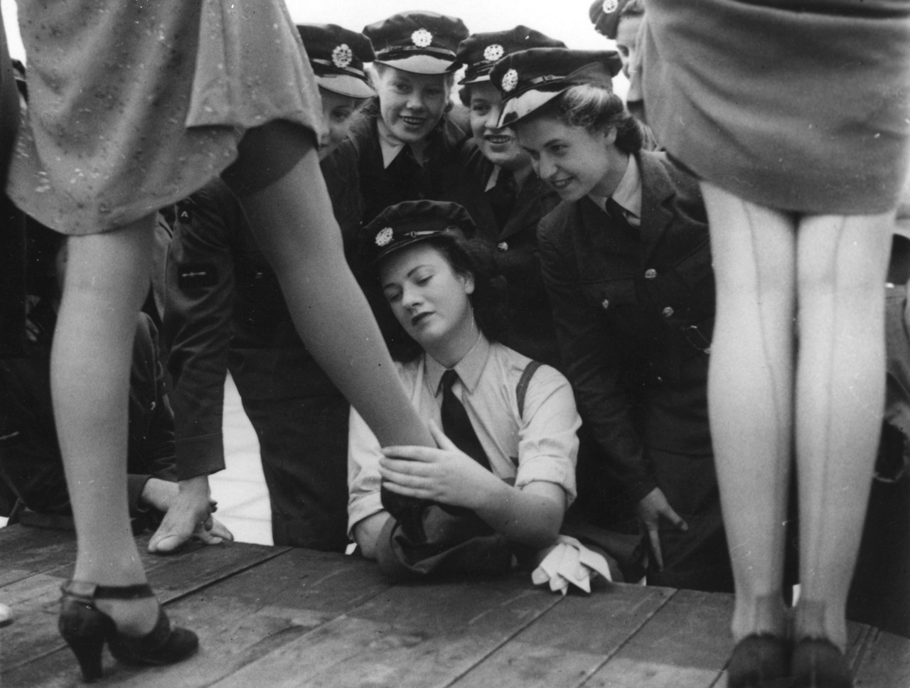 maudelynn:  Service women checking out new, artificial silk-plated, stockings specially designed for them  c.1943