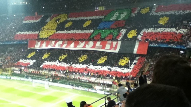 "A Little Bit On The Pac-Fan Side: Milan soccer fans put up a huge Pac-Man mosaic during a game against Barcelona. The text says ""LET'S EAT THEM!"" I have a hard enough time getting my co-workers to replace the bags in the garbage bins each night, so bravo to whoever coordinated this whole thing. (via Kotaku)"