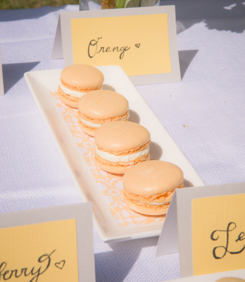 officialfancyflavors:  Orange Macarons!  Photography: Stephanie Ho Floral Arrangements: TrinityBlooms Floral Design