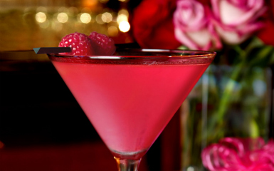 BERRY HOP 2 oz Raspberry Vodka 1 oz Pomegranate juice 1/4 oz Lemon Juice 2 Blackberries 2 Raspberries dash of simple syrup  muddle the fruit in a shaker. add everything else into it and shake up into a martini glass. garnish with a raspberry.