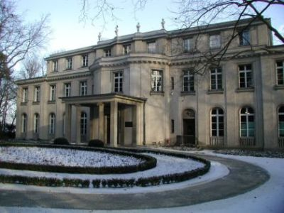 "The Wannsee Conference was a meeting of senior officials of the Nazi German regime, held in the Berlin suburb of Wannsee on 20 January 1942. The purpose of the conference was to inform administrative leaders of Departments responsible for various policies relating to Jews that Reinhard Heydrich had been appointed as the chief executor of the ""Final solution to the Jewish question"". In the course of the meeting, Heydrich presented a plan, presumably approved by Adolf Hitler, for the deportation of the Jewish population of Europe and French North Africa (Morocco, Algeria, and Tunisia) to German-occupied areas in eastern Europe, and the use of the Jews fit for labour on road-building projects, in the course of which they would eventually die according to the text of the Wannsee Protocol, the surviving remnant to be annihilated after completion of the projects."