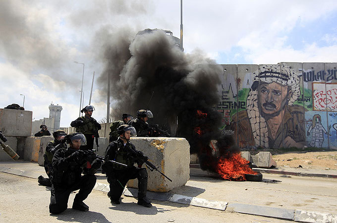Clashes as Palestinians mark 'Land Day' |   Israeli security forces use water cannon and tear gas in clashes with protesters at flashpoint Qalandiya checkpoint.