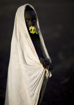 tribal-beauty:  Surma boy with flowers - Turgit Ethiopia by Eric Lafforgue on Flickr.