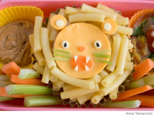 The lion's face is made with a kiddie fave standby: Mac and cheese
