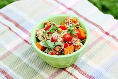 """Zucchini Pasta with Cherry Tomatoes, Sweet Potato, Basil, and Hemp """"Parmesan""""."""