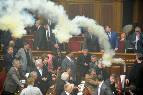 "nationalpost:  Photos: When lawmakers disagree, fists fly, and sometimes smoke bombs, tooIn Canada we are often scandalized by behavior of our politicians: they lie, backtrack on promises, and fight dirty against their opponents with snarky remarks, insults and attack ads.To prove the point, we offer you a peek into some of the more ""heated"" debates which left political opponents bruised and battered in a very literal sense. (Photos: Reuters; AFP Getty Images)"