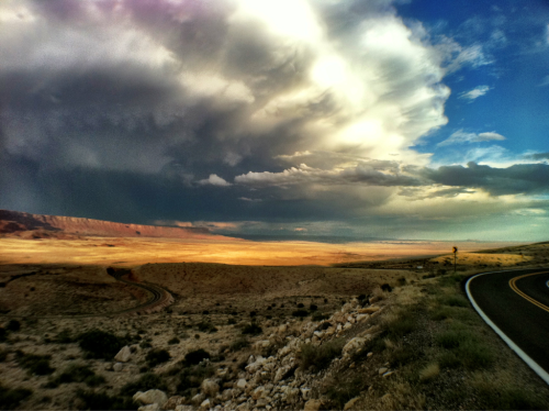 "Utah Landscapes 4 ""Winding Road"" - Near Kanab, UT iPhone 4, Camera+ Weather rolls through the west in a way I never experienced growing up in the east. Bowls of blue sky will be filled with rampaging clouds in the matter of minutes. Cloud breaks and slanting rain light up the sky in endless variation. I had just come down out of the mountain pass on a winding highway and was met with this vista. I had to stop and capture the sinuous road winding through the desert."